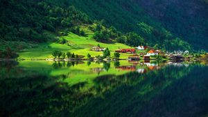 Preview wallpaper village, mountain, bottom, lake, home, summer, reflection, protected