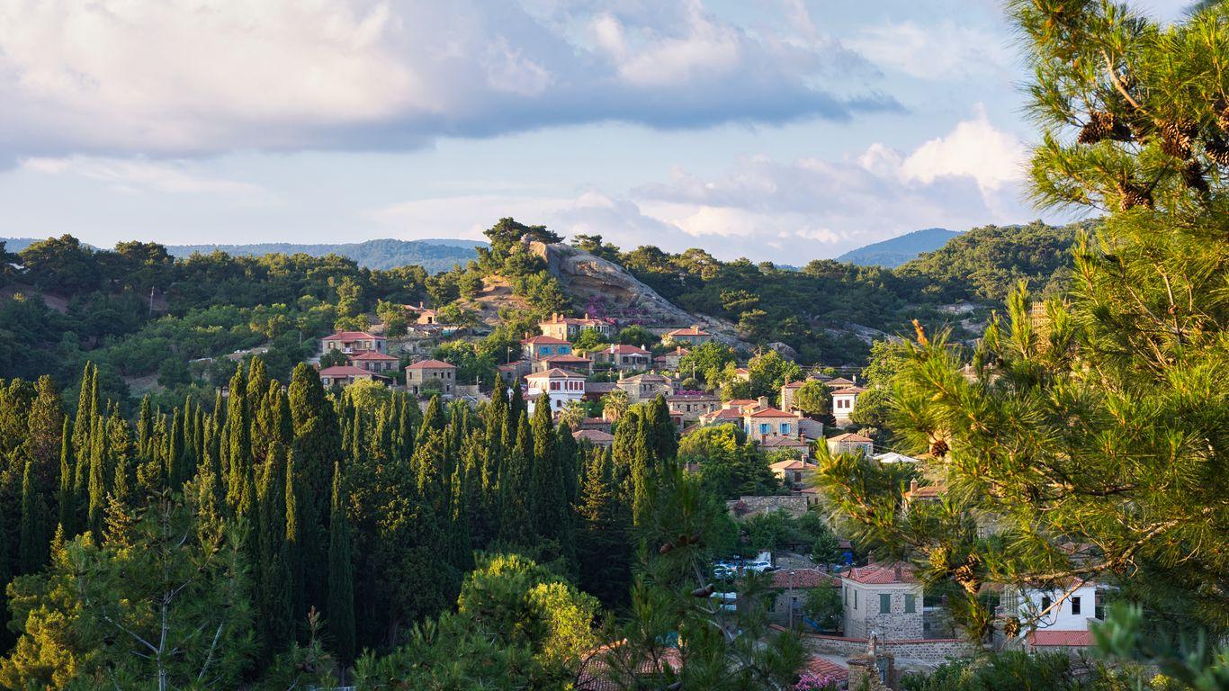 1366x768 Wallpaper village, mountain, buildings, trees