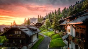 Preview wallpaper village, road, buildings, mountains, sunset