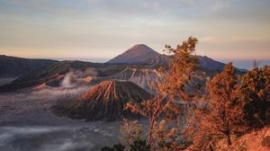 Preview wallpaper volcano, mountains, dawn, sunrise, grass, sky