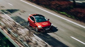 Preview wallpaper volvo, car, red, speed, road, blur