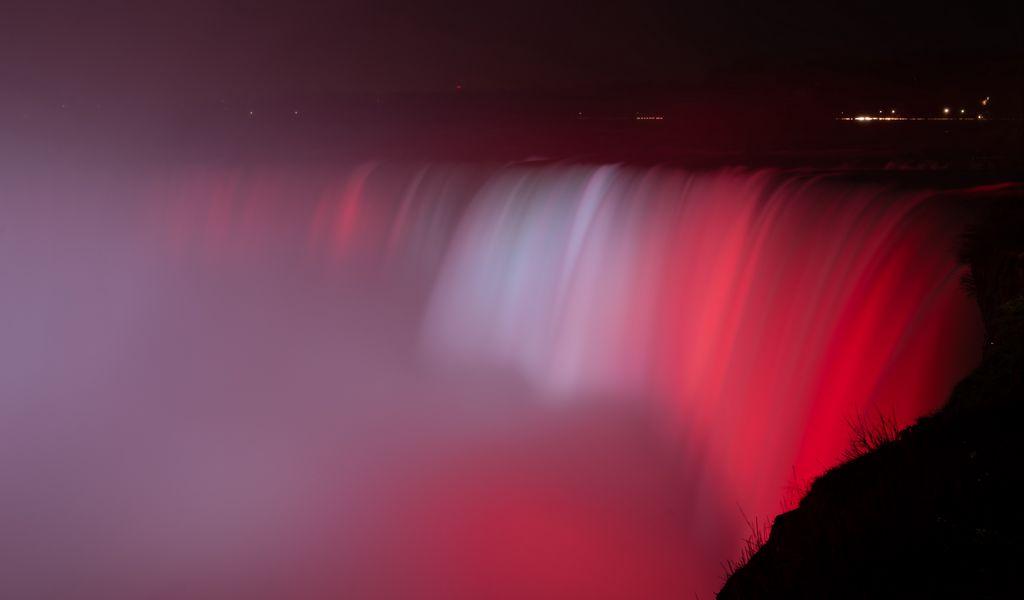1024x600 Wallpaper waterfall, fog, backlight, red, dark