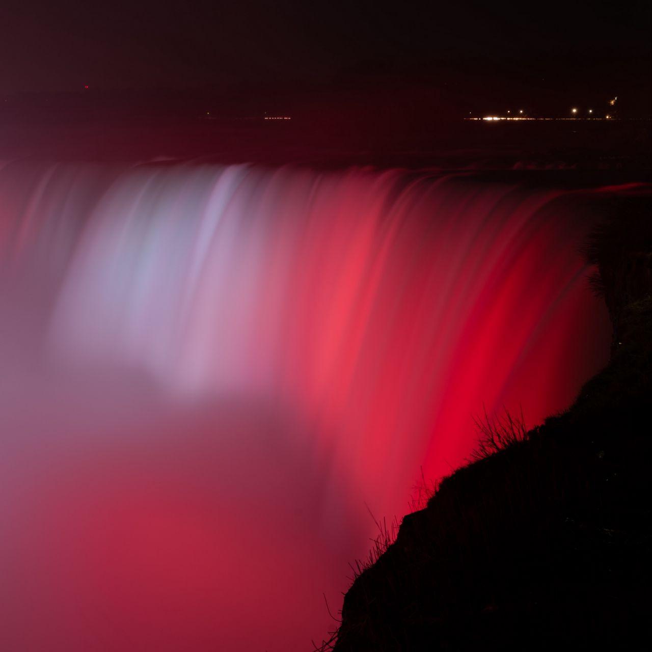 1280x1280 Wallpaper waterfall, fog, backlight, red, dark