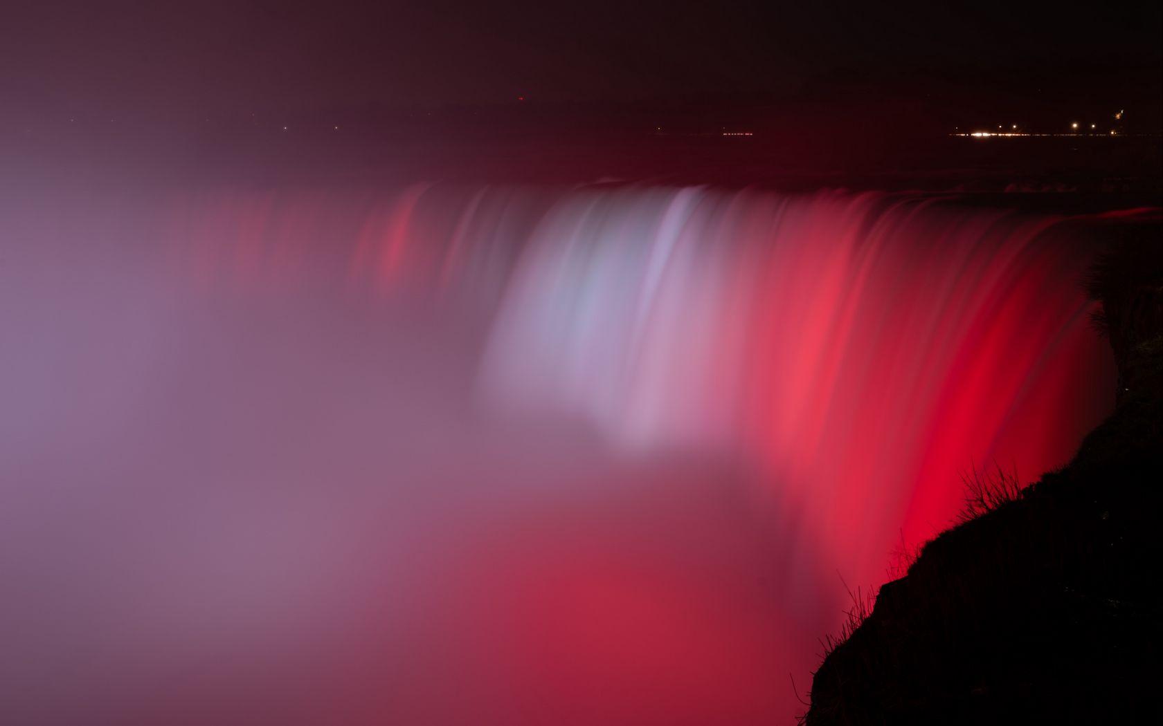 1680x1050 Wallpaper waterfall, fog, backlight, red, dark