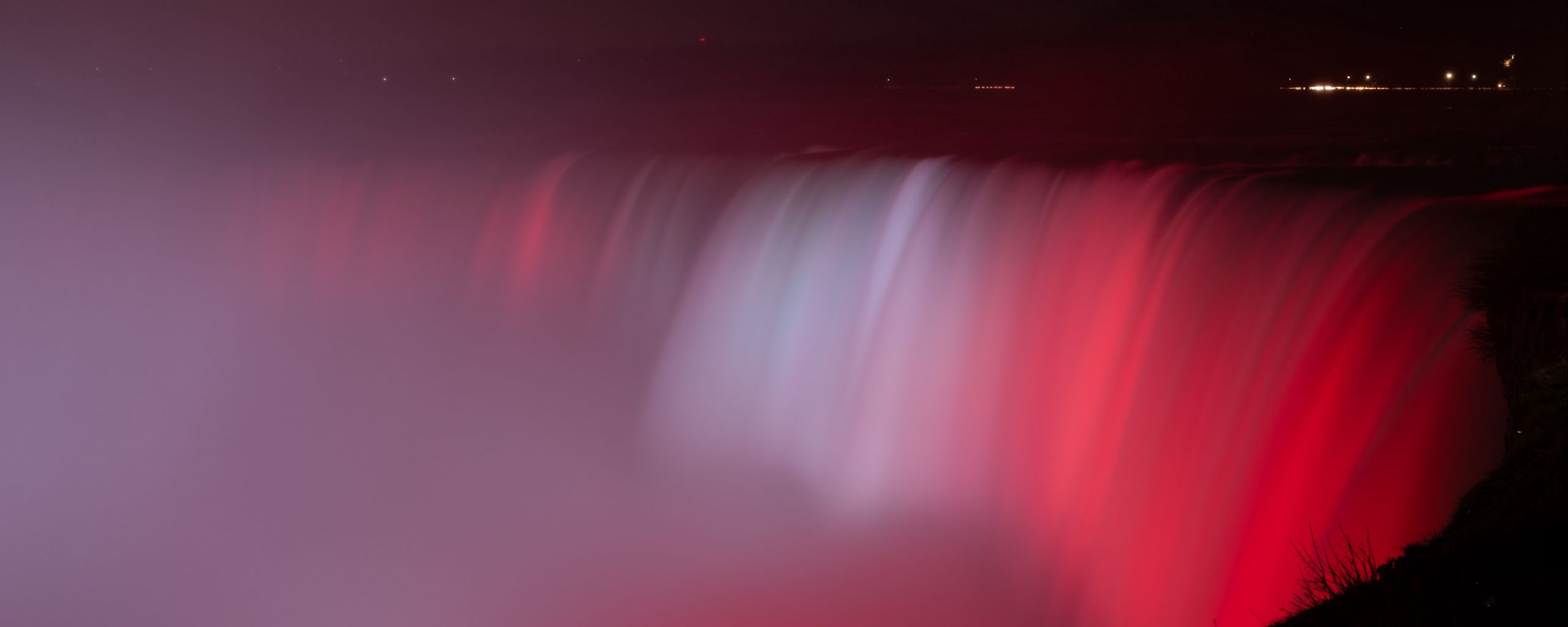 2560x1024 Wallpaper waterfall, fog, backlight, red, dark