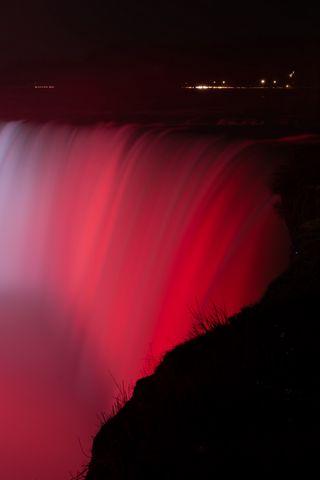 320x480 Wallpaper waterfall, fog, backlight, red, dark
