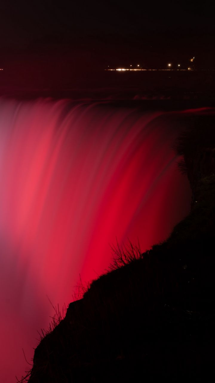 720x1280 Wallpaper waterfall, fog, backlight, red, dark