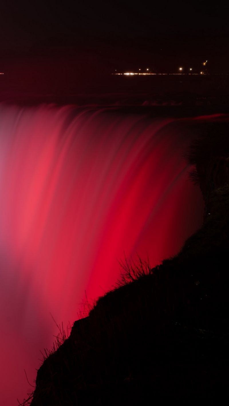 800x1420 Wallpaper waterfall, fog, backlight, red, dark