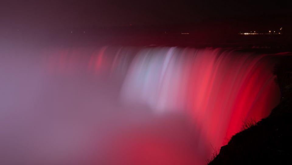 960x544 Wallpaper waterfall, fog, backlight, red, dark