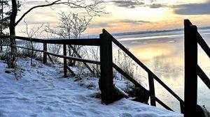 Preview wallpaper winter, river, descent, sky, ladder, handrail