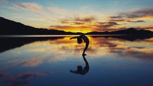 Preview wallpaper yoga, silhouette, lake, horizon