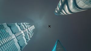 Preview wallpaper skyscrapers, bottom view, plane, minimalism