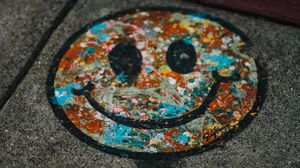 Preview wallpaper smile, colorful, asphalt, paint, graffiti