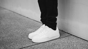 Preview wallpaper sneakers, legs, bw, minimalism