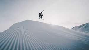 Preview wallpaper snowboarder, snowboard, helmet, snow, jump