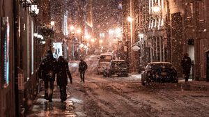 Preview wallpaper snowfall, people, street, night, evening, city, winter