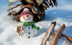 Preview wallpaper snowman, snow, cinnamon, pine cone, christmas, new year