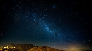 Preview wallpaper starry sky, night, mountains, radiance, glitter