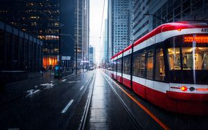 Preview wallpaper street, city, tram, buildings, rain