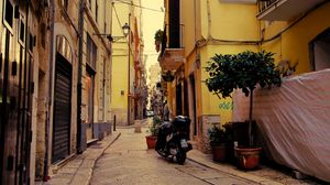 Preview wallpaper street, motorcycle, pavement, buildings, architecture