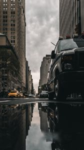 Preview wallpaper street, puddle, reflection, cars, buildings, asphalt