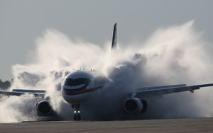 Preview wallpaper sukhoi, superjet, 100, aircraft, smoke, dust