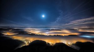 Preview wallpaper switzerland, city, evening, alps, mountains, fog