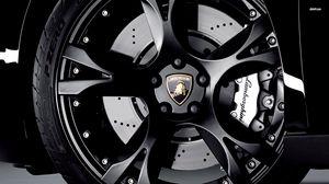 Preview wallpaper tire, rim, black, sports car, lamborghini, emblem