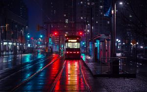 Preview wallpaper trolley, stop, city, evening, lighting