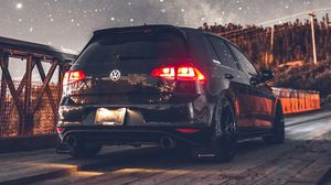 Preview wallpaper volkswagen, car, rear view, headlights, starry sky