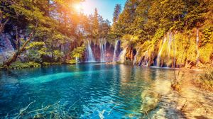 Preview wallpaper waterfall, precipice, sunlight, summer, bright, trees
