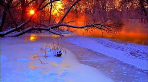 Preview wallpaper winter, sunset, evening, branches, tree, pond, cold, snow